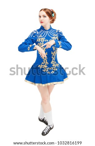 Beautiful woman in dress for Irish dance pointing on hand isolated on white