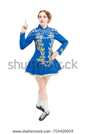 Beautiful woman in dress for Irish dance showing up by finger isolated on white