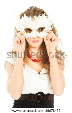 Beautiful woman in dress holding a mask and looking to the camera isolated - stock photo