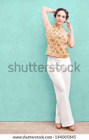Beautiful woman in elegant clothes with copy space - stock photo