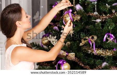 People Decorating For Christmas woman decorating christmas tree fashionable luxury stock photo