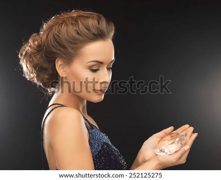 beautiful woman in evening dress with big diamond - stock photo