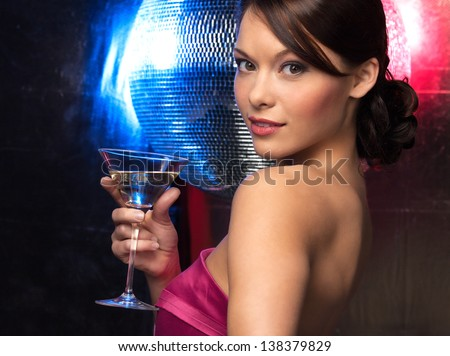 beautiful woman in evening dress with cocktail  and disco ball - stock photo