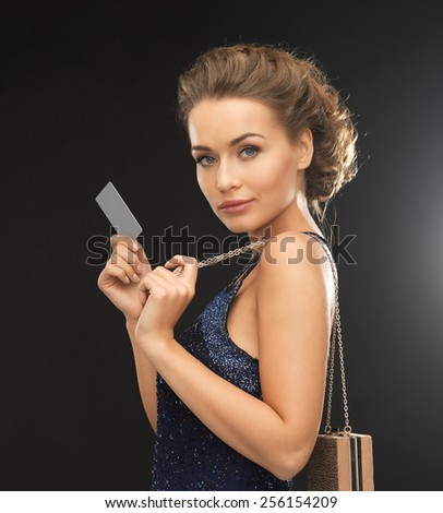 beautiful woman in evening dress with vip card - stock photo