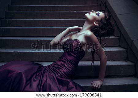 Beautiful woman in front of a building - stock photo