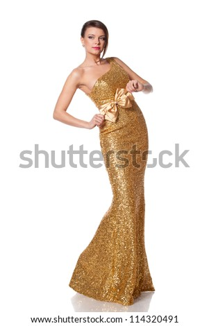 Beautiful woman in full length posing in long golden party dress, over white background - stock photo