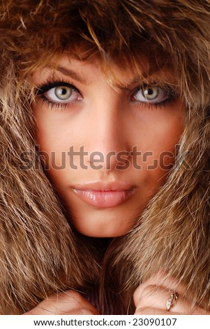 beautiful woman in fur cap with ear flaps