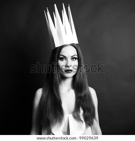 Beautiful woman in geometrical dress in crown. Fashion black and white portrait of queen. - stock photo