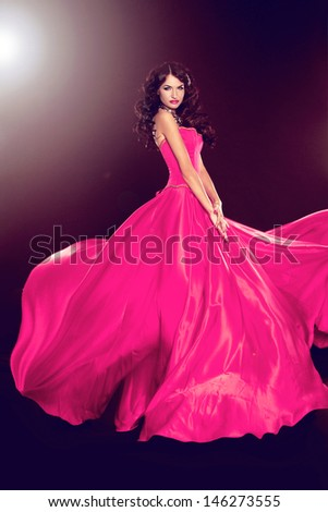 Beautiful woman in gorgeous dress isolated on black background. Full length Portrait. Fashion Photo. - stock photo