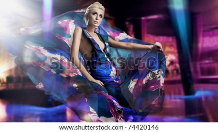 Beautiful woman in gorgeous dress over city background - stock photo