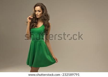 Beautiful woman in green dress - stock photo