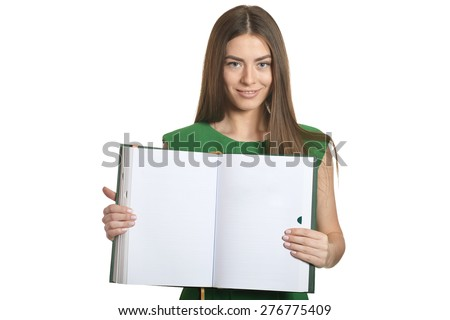 Beautiful woman in green dress with book on white background - stock photo