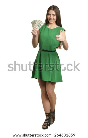 Beautiful woman in green dress with money on white background - stock photo
