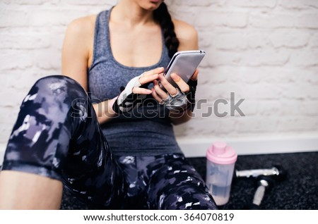 Beautiful woman in gym - stock photo