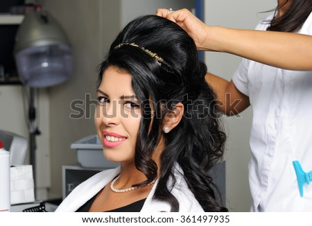 beautiful woman in hair salon - stock photo