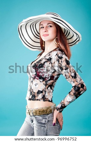 Beautiful woman in hat. isolated on blue background with clipping path