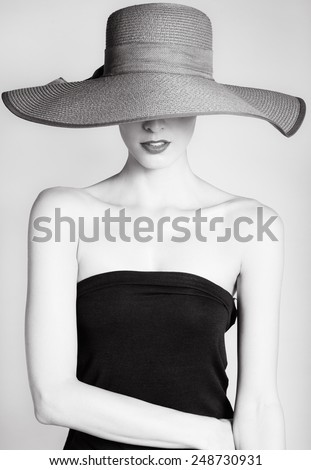 Beautiful woman in hat. Retro fashion - stock photo