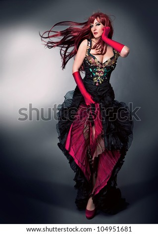 beautiful woman in haute couture evening dress - stock photo