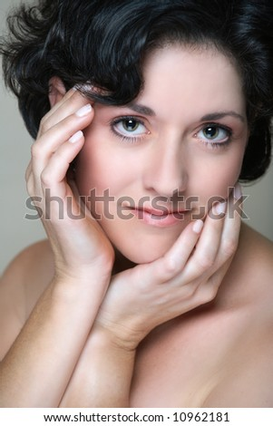 Beautiful woman in her early 40s late 30s with short curly black hair - stock photo