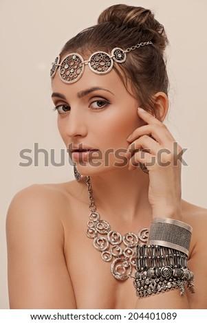 beautiful woman in jewelry with perfect skin - stock photo