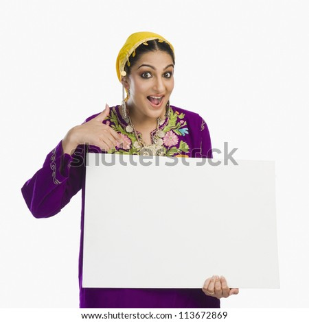 Beautiful woman in Kashmiri dress holding a placard