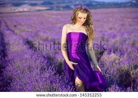Beautiful woman in lavender meadow - stock photo