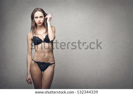 beautiful woman in lingerie on gray background - stock photo