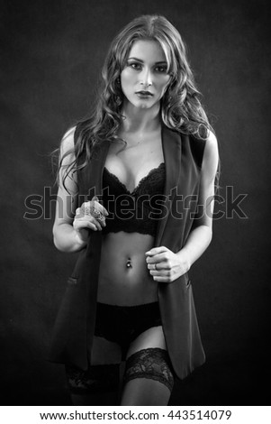 beautiful woman in lingerie undressing, monochrome image - stock photo
