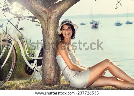 Beautiful woman in love smiling under an olive tree's - stock photo