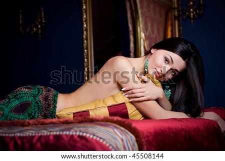 Beautiful woman in luxury Bedroom - stock photo