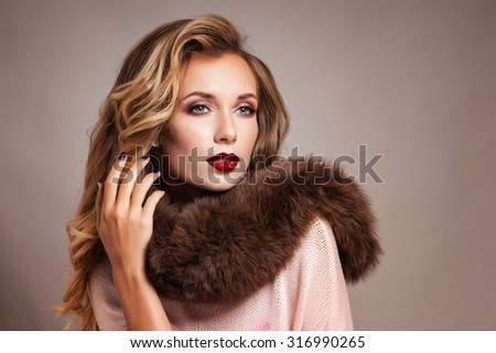 Beautiful Woman in Luxury Fur Coat. Sepia Toned.Vintage Style - stock photo