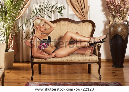 Beautiful woman in luxury underwear in antique lounge - stock photo