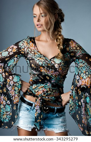 beautiful woman in many-colored blouse - stock photo