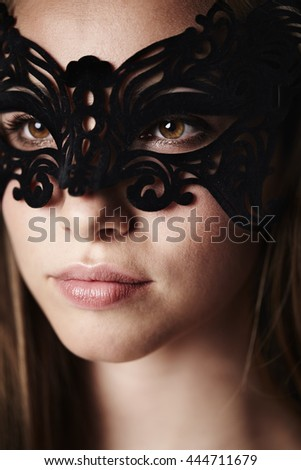 Beautiful woman in mask, close up - stock photo