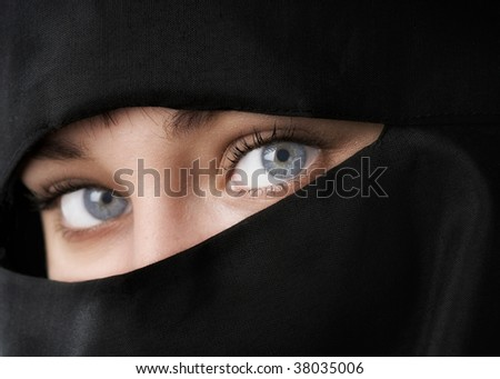 Beautiful Woman in Middle Eastern Niqab veil - stock photo