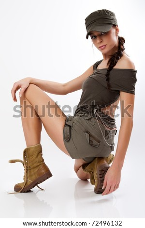Beautiful woman in military clothes. - stock photo