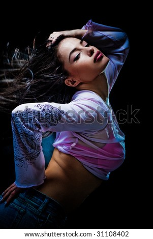 beautiful woman in motion, studio dark background - stock photo