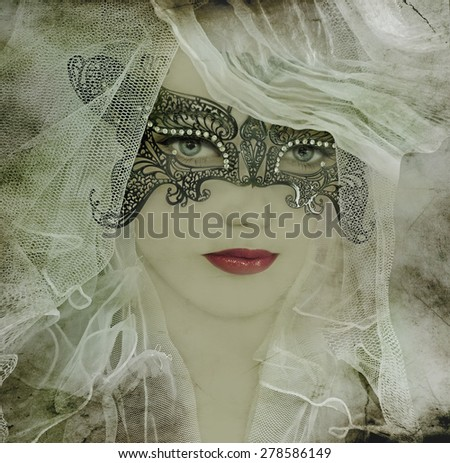 Beautiful woman in mysterious mask. - stock photo