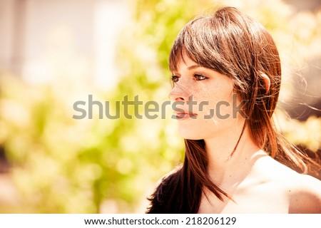 Beautiful woman in nature - stock photo