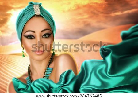 Beautiful woman in oriental style in turban - stock photo