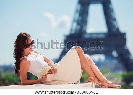 Beautiful woman in Paris background the Eiffel tower  - stock photo