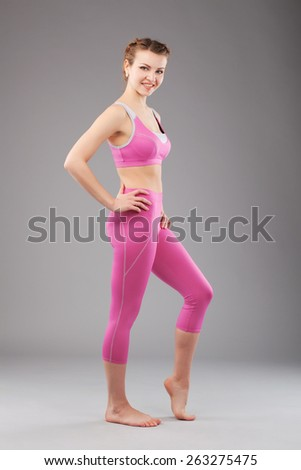 Beautiful woman in pink sporty suit - stock photo