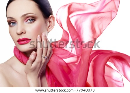 Beautiful woman in red color scarf - stock photo