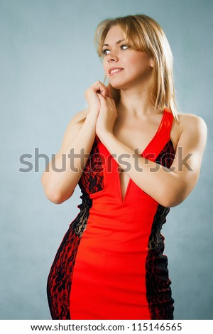 Beautiful woman in red dress - stock photo