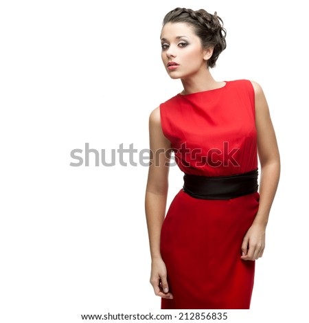 beautiful woman in red dress standing isolated on white - stock photo