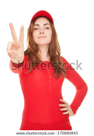 Beautiful woman in red showing victory sign or peace isolated on white - stock photo