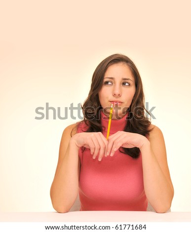 Beautiful woman in red top with a pencil - stock photo