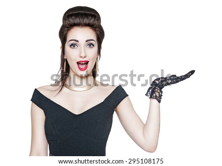 Beautiful woman in retro pin up style holding something on her hand isolated  - stock photo