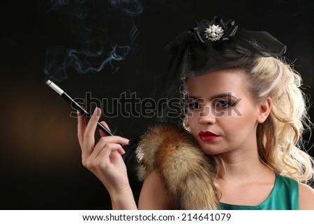 Beautiful woman in retro style, on dark background - stock photo