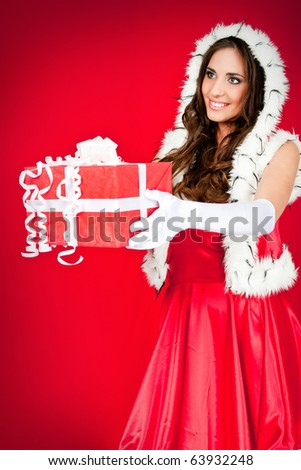 beautiful woman in santa costume with present, side view - stock photo